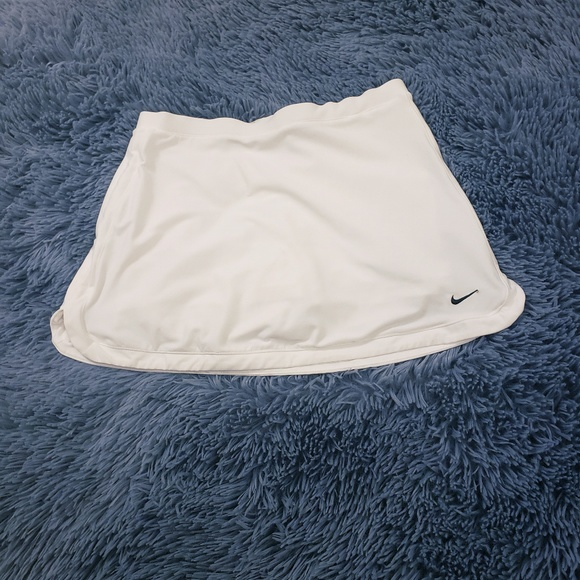 Nike Dresses & Skirts - Nike fit dry white tennis skirt with shorts under
